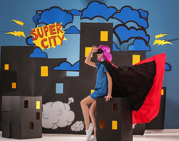 Cute girl as superhero against decoration. Comic strip city them